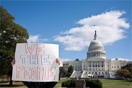 A protestor holding a placard in front of the US Capitol Building Stock Photo - Premium Royalty-Free, Code: 653-03706766