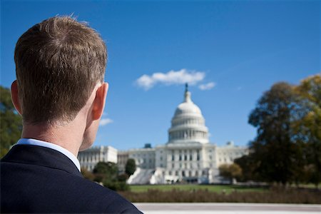 A politician in front of the US Capitol Building Stock Photo - Premium Royalty-Free, Code: 653-03706775