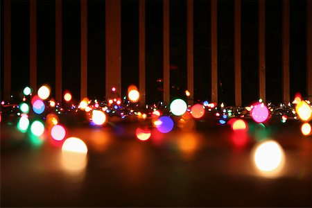 Strings of illuminated Christmas lights laying on a balcony, outdoors Stock Photo - Premium Royalty-Free, Code: 653-03844248