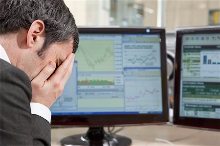 people in panic - Businessman feels the finance pressure Stock Photo - Premium Royalty-Free, Code: 653-03844395