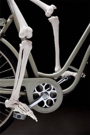 foot model - A skeleton on a bicycle, low section Stock Photo - Premium Royalty-Free, Code: 653-03843134