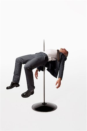 spike - A businessman impaled on a spindle Stock Photo - Premium Royalty-Free, Code: 653-03843145