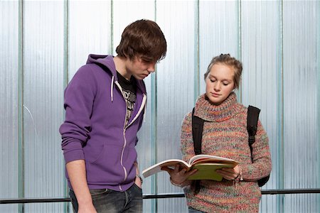 stage show - A teenage boy and girl looking at a school workbook together Stock Photo - Premium Royalty-Free, Code: 653-03843156