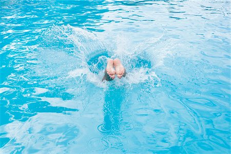 preteen feet - Detail of a boy diving into a swimming pool Stock Photo - Premium Royalty-Free, Code: 653-03843279