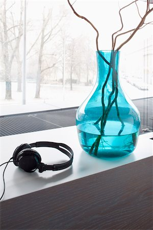Headphones and vase with twigs on window sill. Stock Photo - Premium Royalty-Free, Code: 653-03843556