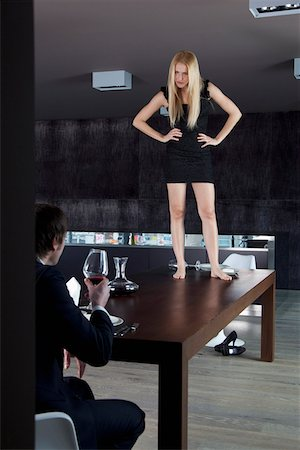dominant woman - Girlfriend stands on dinner table displeased with her boyfriend. Stock Photo - Premium Royalty-Free, Code: 653-03843552