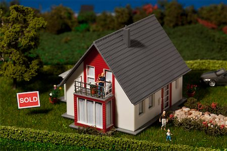 sold sign - A diorama of a miniature house with a family of figurines and a SOLD sign Stock Photo - Premium Royalty-Free, Code: 653-03843597
