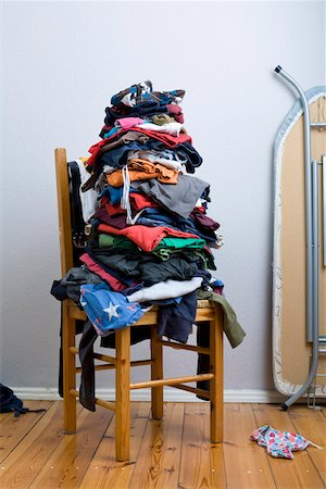 A big untidy stack of clean clothes waiting to be ironed Stock Photo - Premium Royalty-Free, Code: 653-03843816