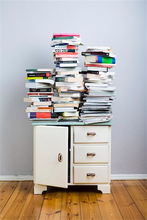 Stacks of books on a cabinet Stock Photo - Premium Royalty-Free, Code: 653-03843820
