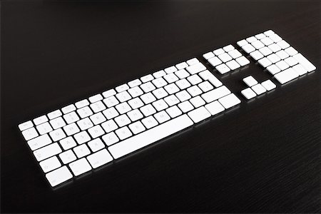 Separate computer keys arranged to look like an actual keyboard Stock Photo - Premium Royalty-Free, Code: 653-03843821