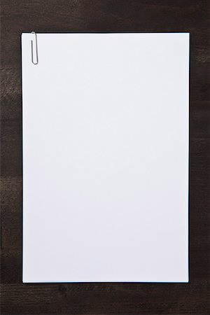 paper - Paper clipped blank paper Stock Photo - Premium Royalty-Free, Code: 653-03843834