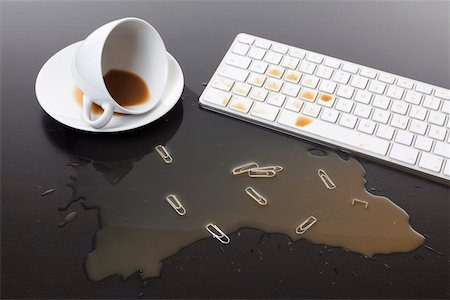 spill - A cup of coffee spilled on a computer keyboard Stock Photo - Premium Royalty-Free, Code: 653-03843839