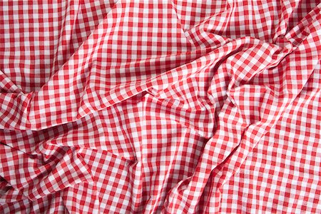 A wrinkled gingham picnic blanket Stock Photo - Premium Royalty-Free, Code: 653-03843847