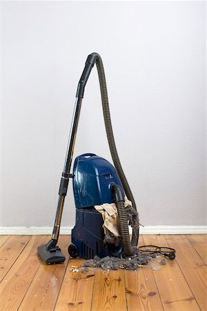 dirty - Vacuum cleaner with an exploded vacuum cleaner bag Stock Photo - Premium Royalty-Free, Code: 653-03843840