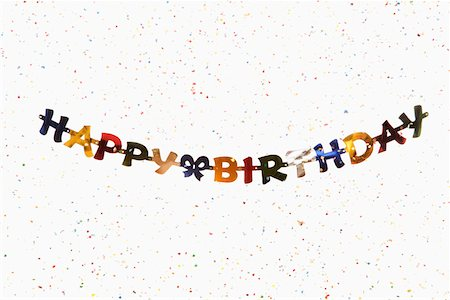 A hanging banner spelling HAPPY BIRTHDAY with confetti Stock Photo - Premium Royalty-Free, Code: 653-03843892