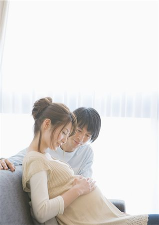 pregnant asian - Man taking care of his pregnant wife Stock Photo - Premium Royalty-Free, Code: 669-06023073