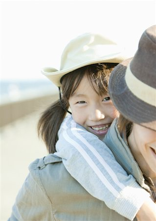 dependable - Girl being given piggyback by father Stock Photo - Premium Royalty-Free, Code: 669-03708720