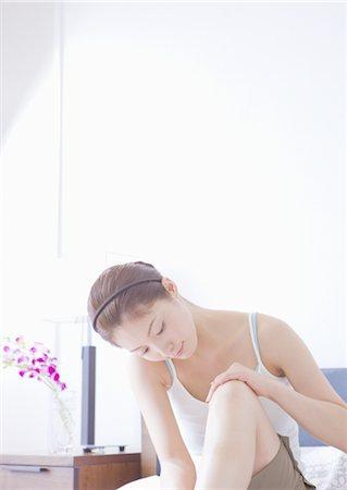 foot massage - Woman massaging her legs Stock Photo - Premium Royalty-Free, Code: 669-03708965