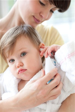 Taking a toddler's temperature Stock Photo - Premium Royalty-Free, Code: 679-04249889