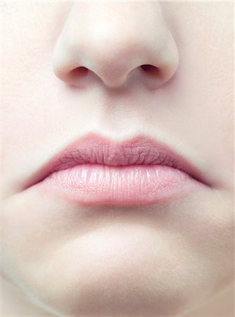 Unhappy woman's mouth Stock Photo - Premium Royalty-Free, Code: 679-05797458