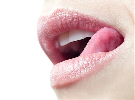 Woman licking her lips Stock Photo - Premium Royalty-Free, Code: 679-05797462