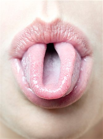 Woman rolling her tongue Stock Photo - Premium Royalty-Free, Code: 679-05797463