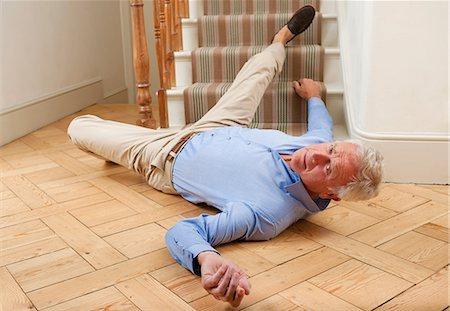 falling - Senior man injured in a fall Stock Photo - Premium Royalty-Free, Code: 679-05797718