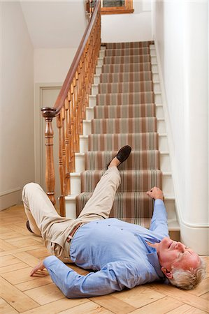 falling - Senior man injured in a fall Stock Photo - Premium Royalty-Free, Code: 679-05797719