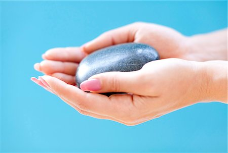 smooth - Stone in a woman's hand. Stock Photo - Premium Royalty-Free, Code: 679-05996466
