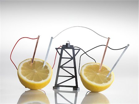 reaction - Electrical circuit with lemons. A chemical reaction between the copper and zinc plates and the lemon produces a small current, that is able to power a light bulb. Stock Photo - Premium Royalty-Free, Code: 679-05996488