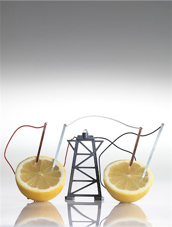 reaction - Electrical circuit with lemons. A chemical reaction between the copper and zinc plates and the lemon produces a small current, that is able to power a light bulb. Stock Photo - Premium Royalty-Free, Code: 679-05996491