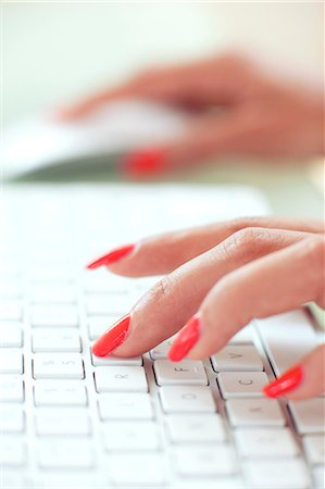 Woman using a computer. Stock Photo - Premium Royalty-Free, Code: 679-05992425