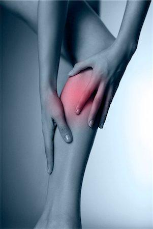 Calf pain, conceptual image. Woman massaging her sore calf. Stock Photo - Premium Royalty-Free, Code: 679-06671865