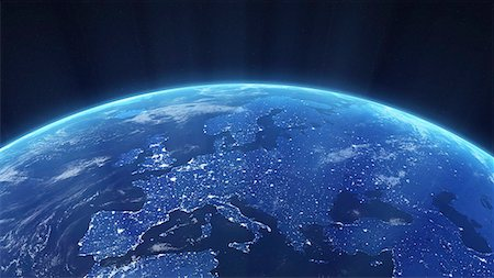 Europe at night. Computer artwork of the Earth from space with lights glowing in urban areas. Stock Photo - Premium Royalty-Free, Code: 679-06672827