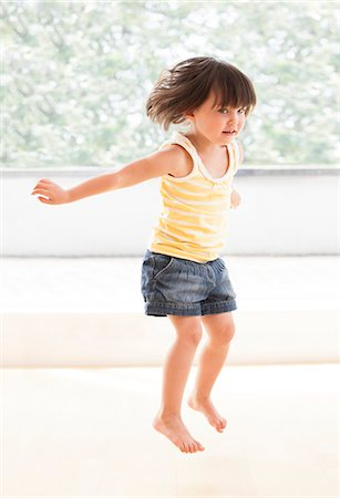 Toddler jumping. Stock Photo - Premium Royalty-Free, Code: 679-06673193