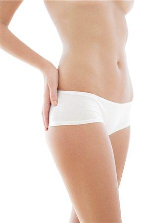 Woman's abdomen. Stock Photo - Premium Royalty-Free, Code: 679-06673215