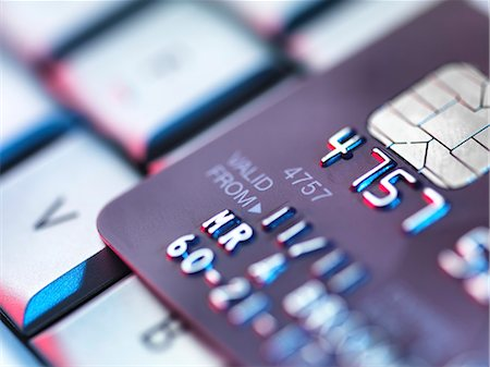 ebusiness - Internet shopping, conceptual image. Credit card on a computer keyboard. Stock Photo - Premium Royalty-Free, Code: 679-06673642