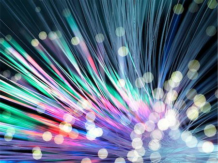 Optical fibres emitting light. Optical fibres are used in telecommunications to transmit data at high speed. Stock Photo - Premium Royalty-Free, Code: 679-06673654
