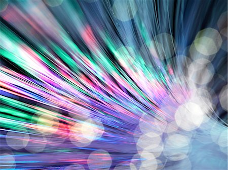 fibre optic - Optical fibres emitting light. Optical fibres are used in telecommunications to transmit data at high speed. Stock Photo - Premium Royalty-Free, Code: 679-06673655