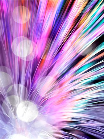 Optical fibres emitting light. Optical fibres are used in telecommunications to transmit data at high speed. Stock Photo - Premium Royalty-Free, Code: 679-06673659