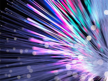 fibre optic - Optical fibres emitting light. Optical fibres are used in telecommunications to transmit data at high speed. Stock Photo - Premium Royalty-Free, Code: 679-06673660