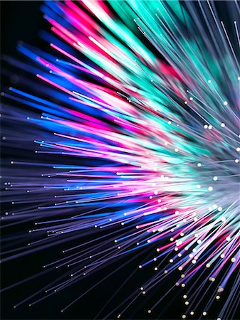 fibre optic - Optical fibres emitting light. Optical fibres are used in telecommunications to transmit data at high speed. Stock Photo - Premium Royalty-Free, Code: 679-06673661