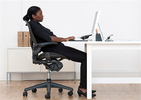 Incorrect seated posture. Stock Photo - Premium Royalty-Free, Code: 679-06673769