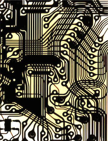Macrophotograph of a printed circuit. A printed circuit consists of lines of a metal conductor printed on an insulating material base. The metal lines form a circuit that connects electronic components and so forms a functioning device. Stock Photo - Premium Royalty-Free, Code: 679-06673887