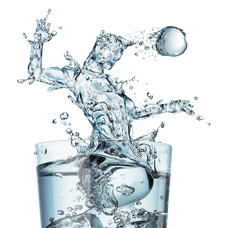 Sports hydration, conceptual computer artwork. Glass of water with a splash shaped as a football player heading the ball. Stock Photo - Premium Royalty-Free, Code: 679-06673969