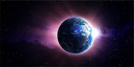 Sun setting behind Earth, computer artwork. Stock Photo - Premium Royalty-Free, Code: 679-06713813