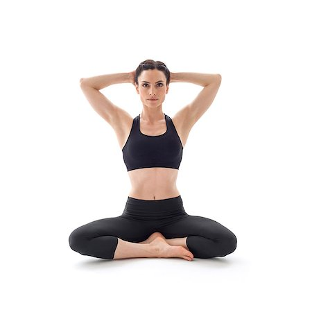 sit - Woman practicing yoga. This is the auspicious pose. Stock Photo - Premium Royalty-Free, Code: 679-07607058