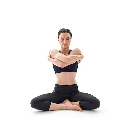 sit - Woman practicing yoga. This is the auspicious pose. Stock Photo - Premium Royalty-Free, Code: 679-07607059