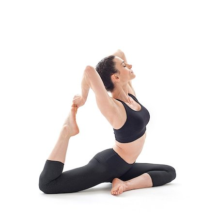 sitting - Woman practicing yoga. This is the pigeon pose. Stock Photo - Premium Royalty-Free, Code: 679-07607051