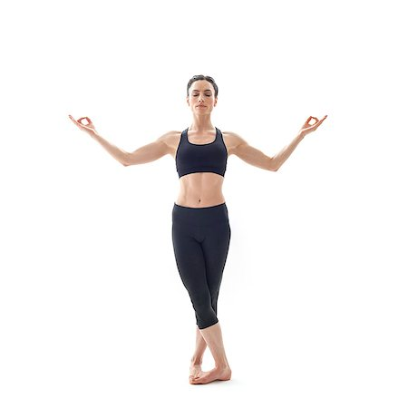 Woman practicing yoga. This is the tree Mudra pose. Stock Photo - Premium Royalty-Free, Code: 679-07607079